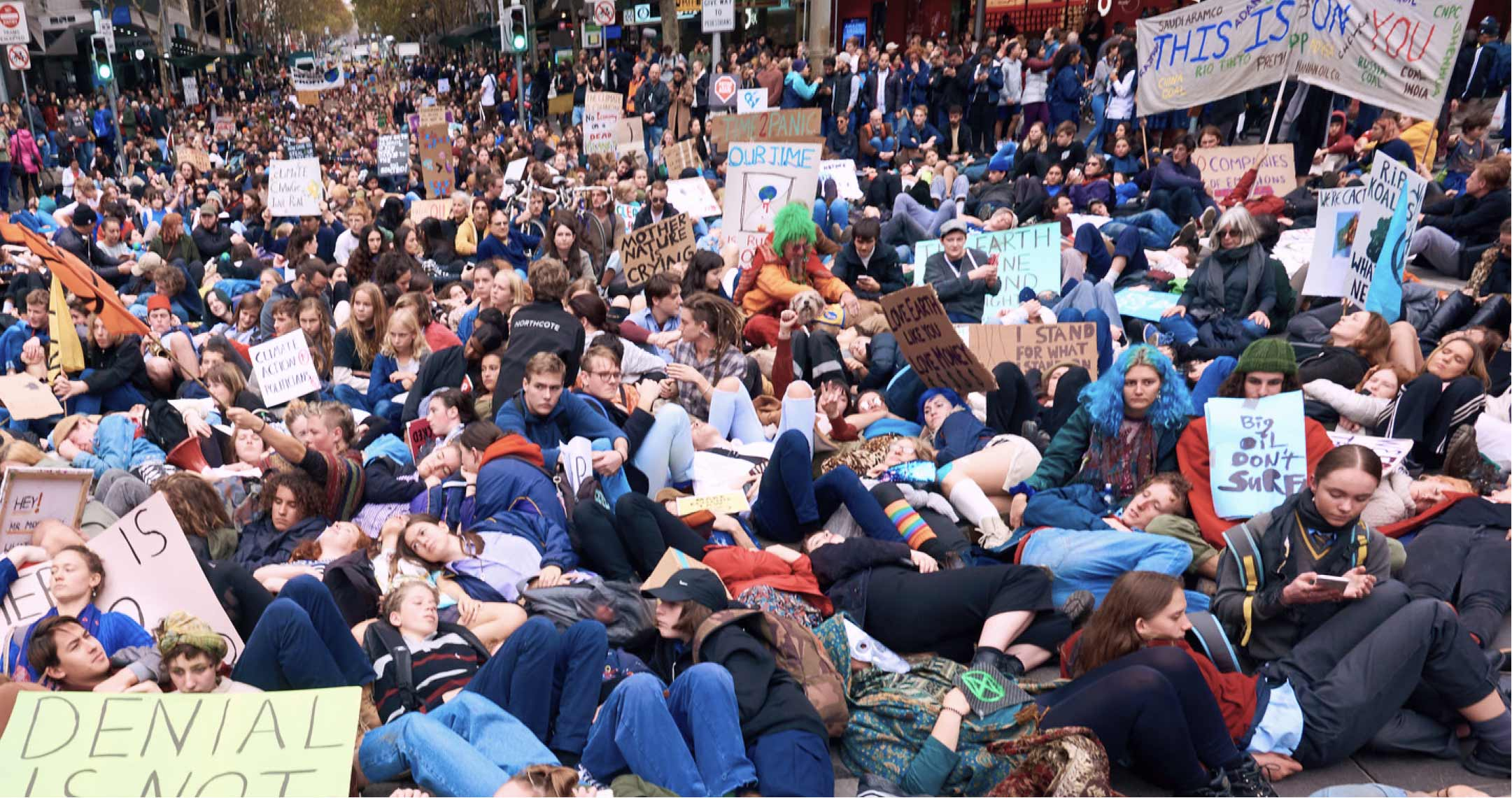 Thousands of people taking part in a 'Die-in' action in the streets of Melbourne